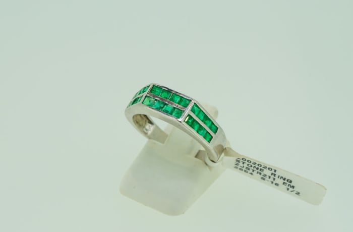 Emerald stone and silver ring channel setting men's wedding band image