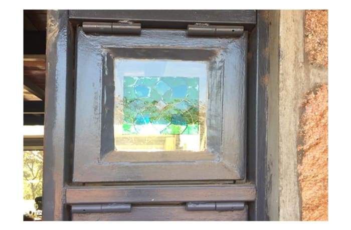 Glass pane in frame with a blue symmetric pattern image