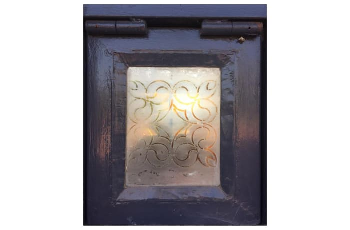 Glass pane in frame with a symmetric pattern image
