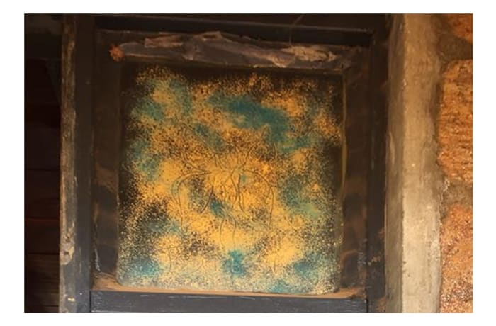 Glass pane in frame with bronze hues image