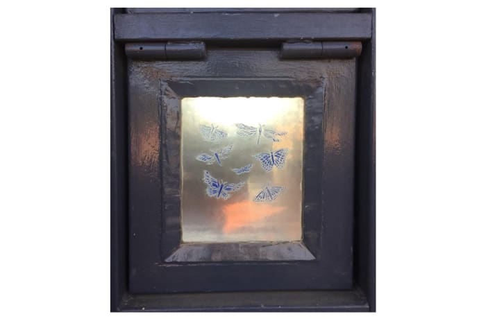Glass pane in frame with butterflies and dragonflies image