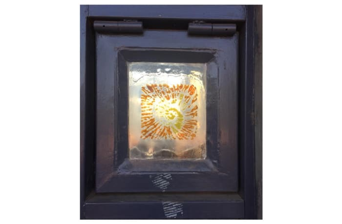 Glass pane in frame with snail pattern image