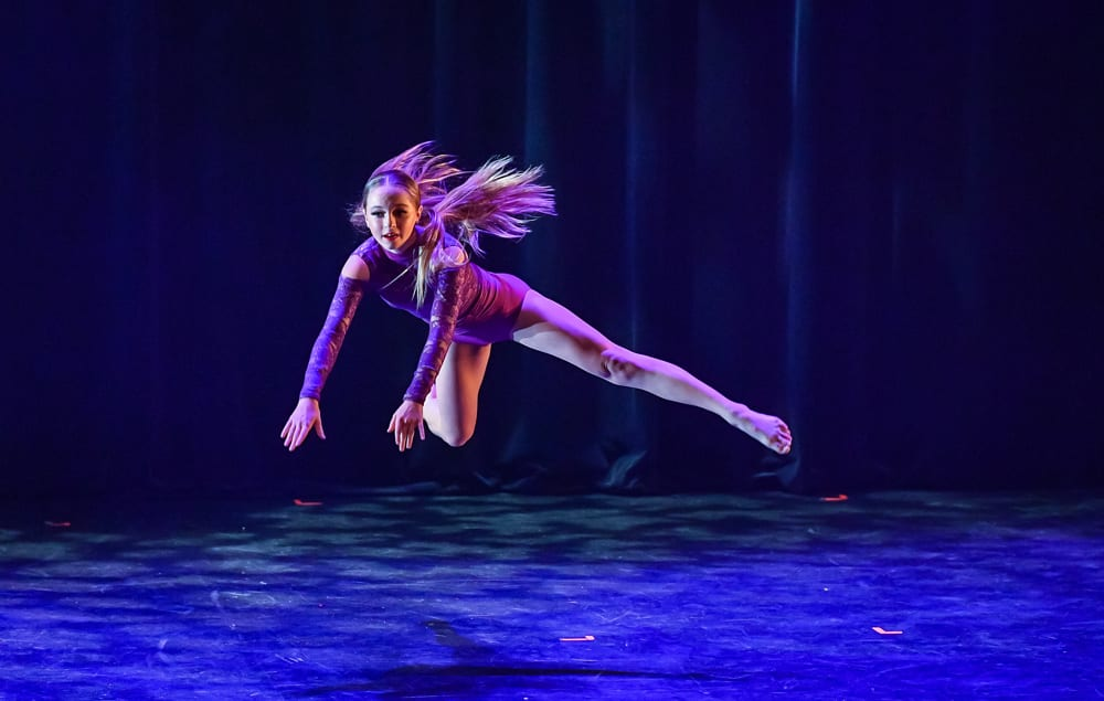 Ikin Elite dancer flying through the air during a performance