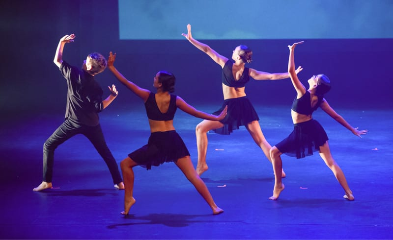 Contemporary Dancers performing on stage at Ikin Dance showcase
