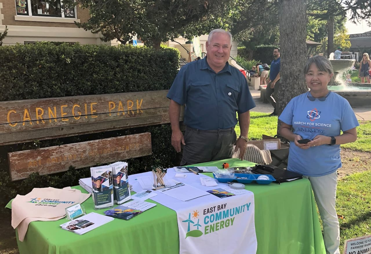 Two volunteers for EBCE at a park event.