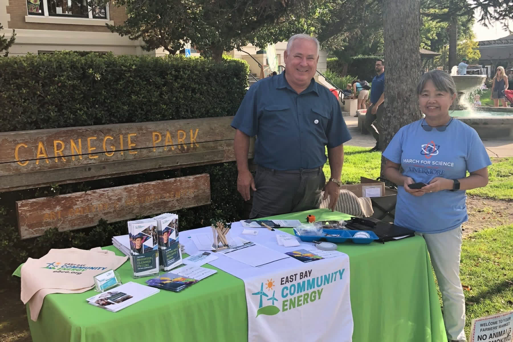 Two volunteers at a booth at a Livermore event