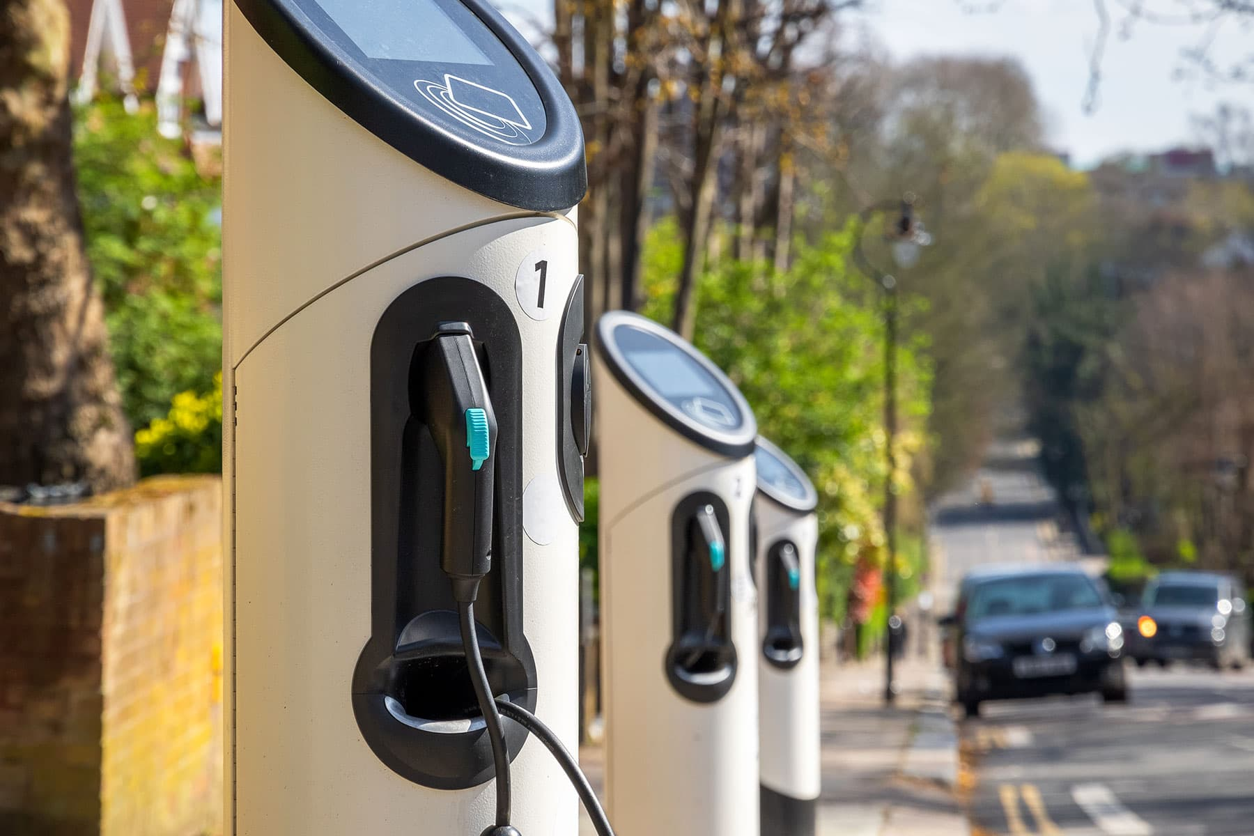 A row of EV chargers on the street