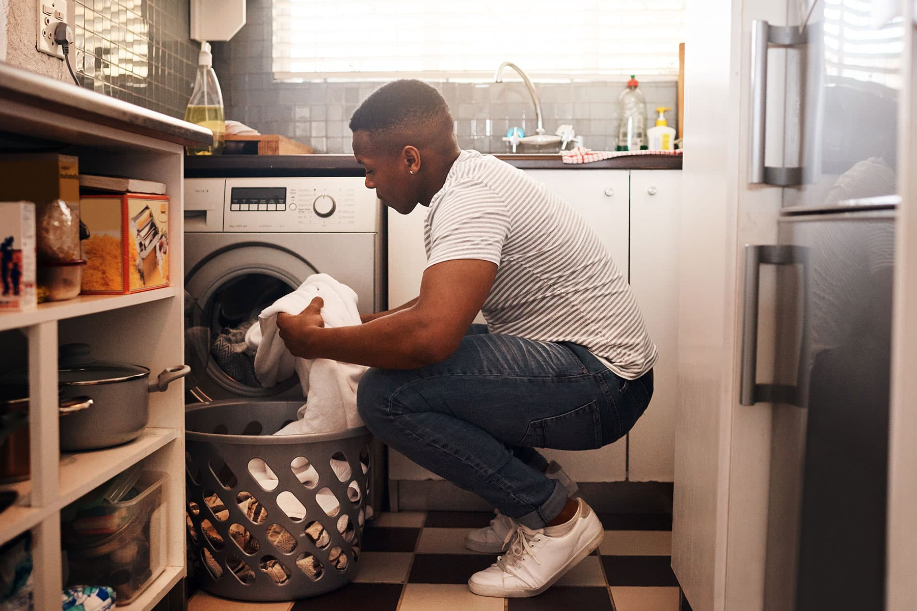 Young man loading laundry