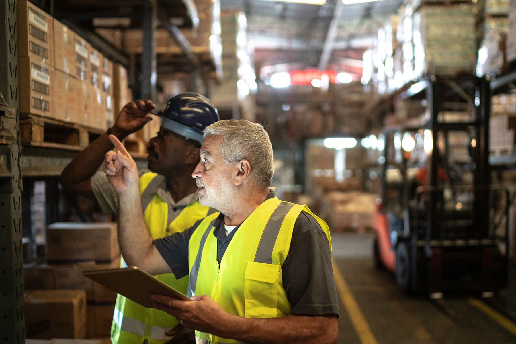 Two men working in a warehouse.