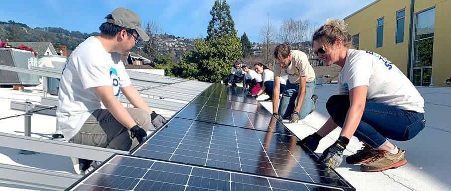 volunteers installing solar panels
