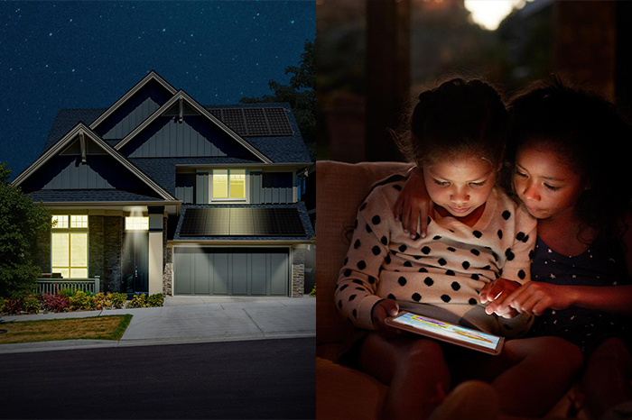 Home with lights on and two girls reading in dark