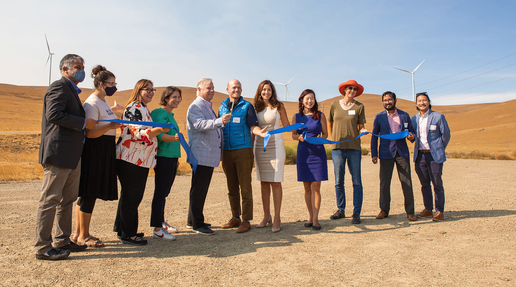 EBCE team members cutting ribbon in front of wind energy center