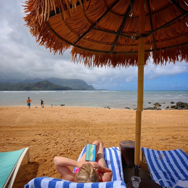 Lounging on beach at St Regis Princeville, Kauai