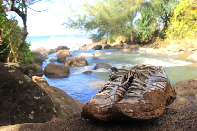 muddy hiking shoes on the Kalalau Trail