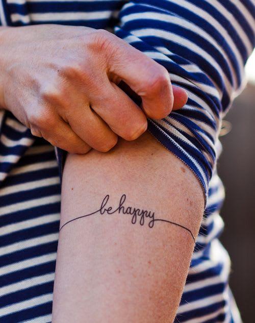 tatuaggio be happy braccio