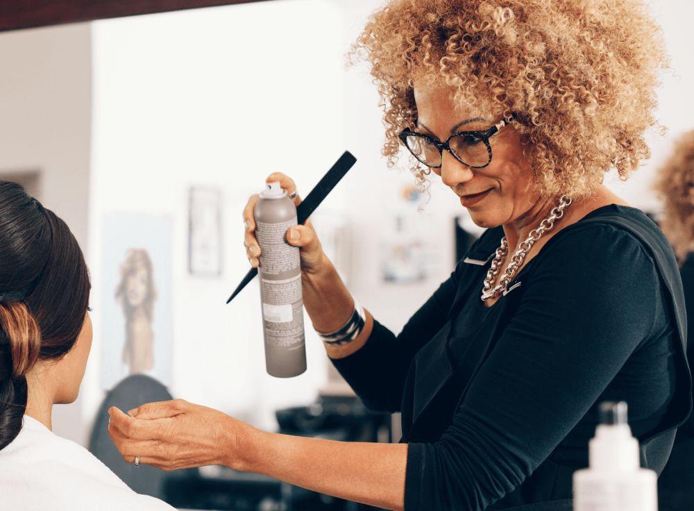 hairdresser doing woman's hair