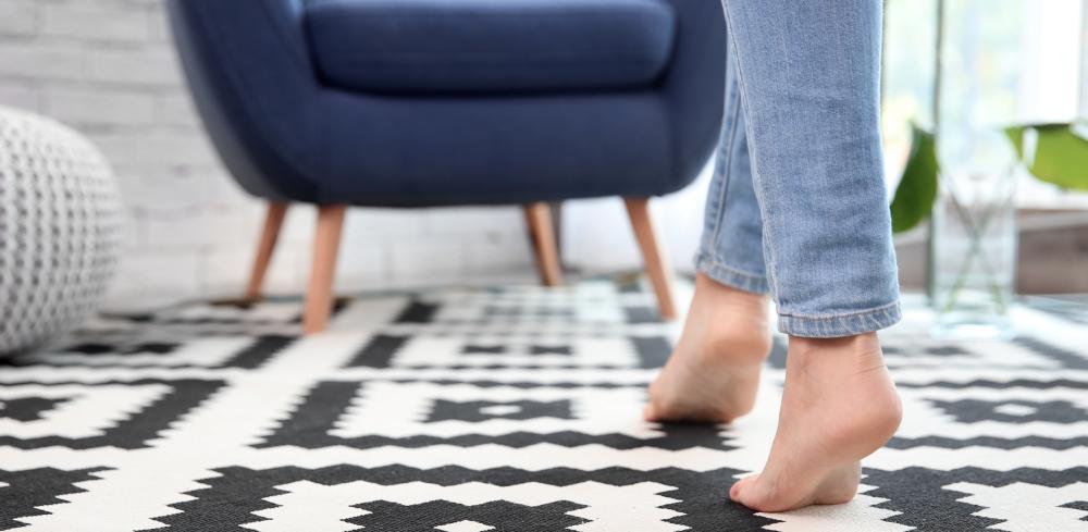 woman walking bare foot at home