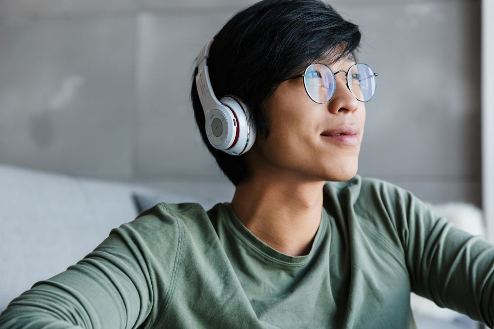 a young man wearing wireless headphones