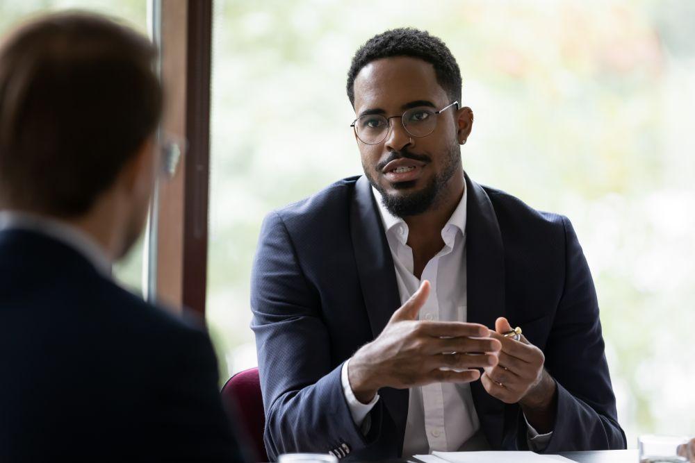 Focused businessman speak with coworker