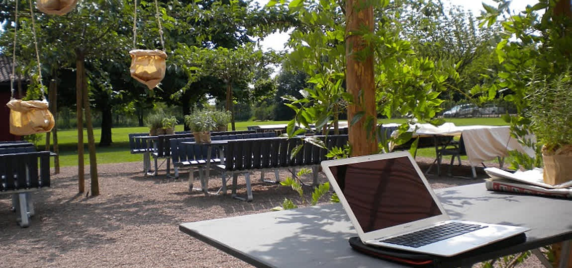 Zen garden with a lapton on a garden table