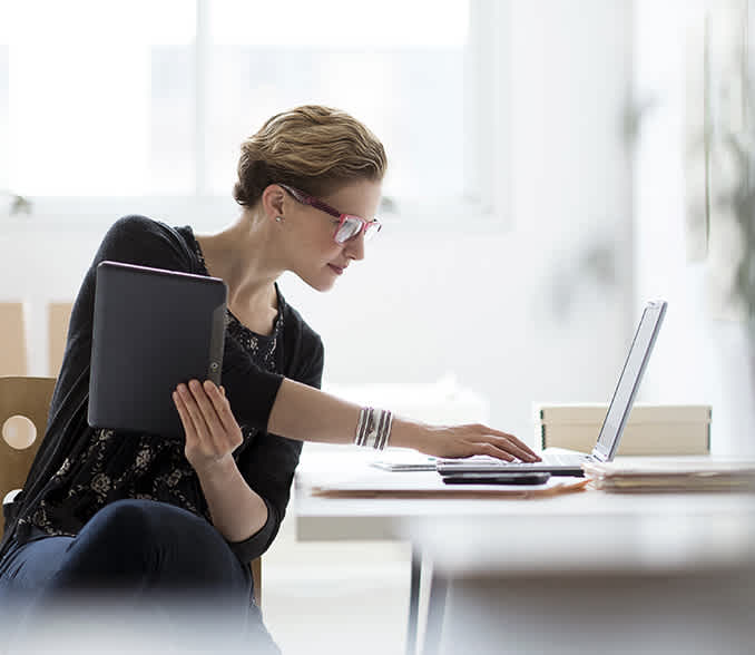 Woman with a tablet a laptop