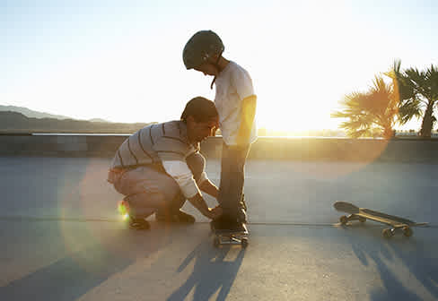 Father and son with a skateboard