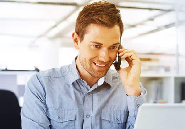 A man arranges property insurance by the phone