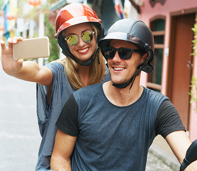 transactional or. personal youth account, couple on scooter with smartphone