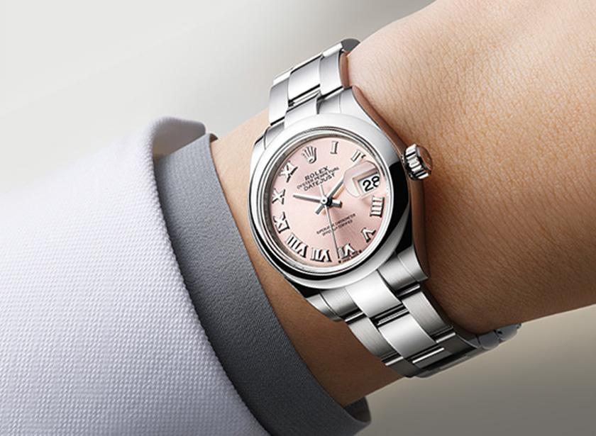 women's wrist with a rolex watch on