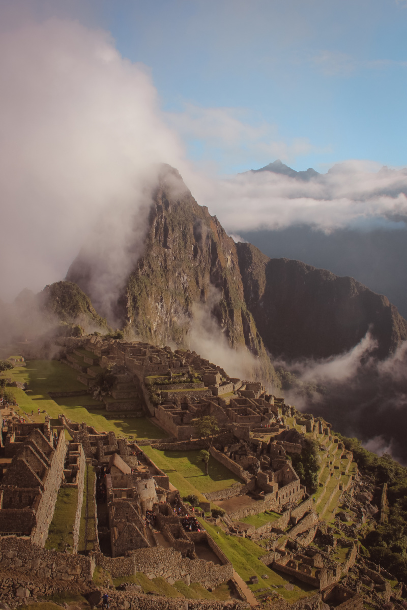 Magical Machu Picchu breaking through the early morning clouds