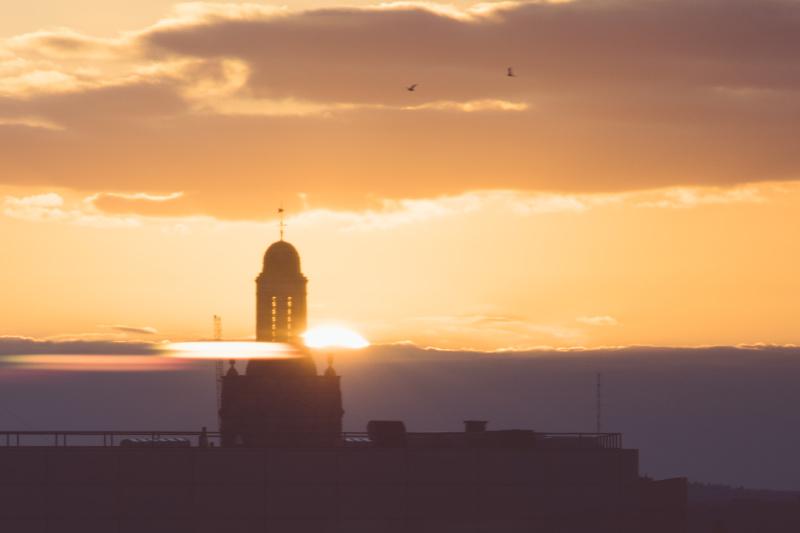 Sunset through the skyline of Boston