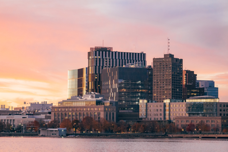 MIT campus at sunset across the Charles