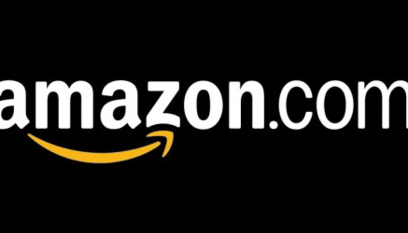 Large black background with Amazon.com logo in white letters with yellow arrow-swish related to acquisition of Whole Foods.