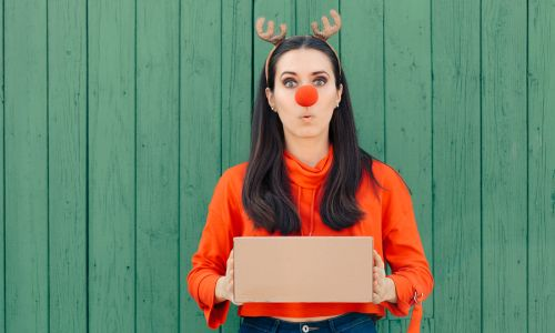 Bigstock Funny Christmas Delivery Girl 262018429