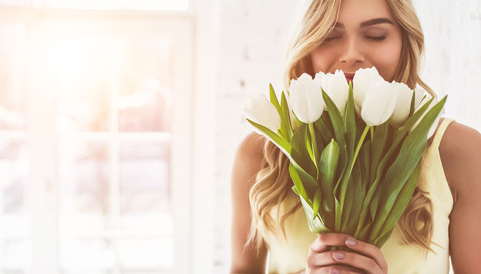 Bigstock Young Woman With Tulips 227973727