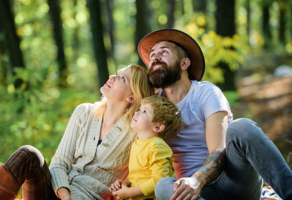 Bigstock Happy Son With Parents Relax I 294739714