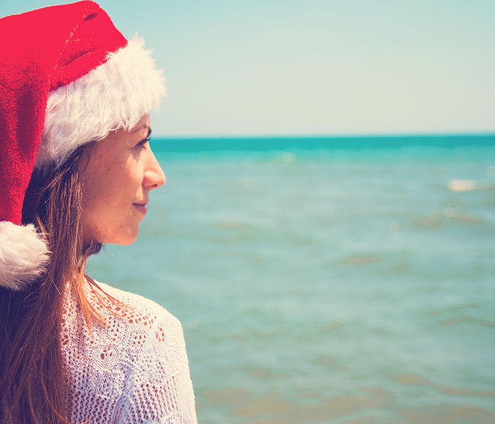Bigstock Young Woman In Santa Hat On Tr 259515667