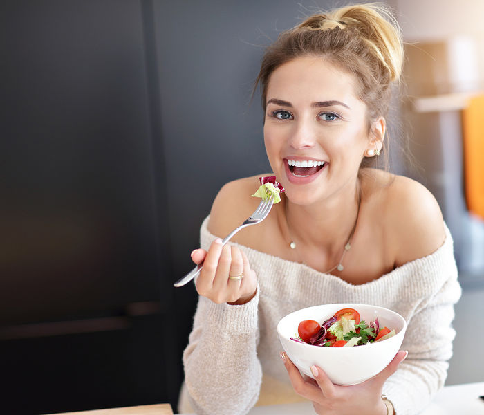 Bigstock Beautiful Smiling Woman Eating 268846516