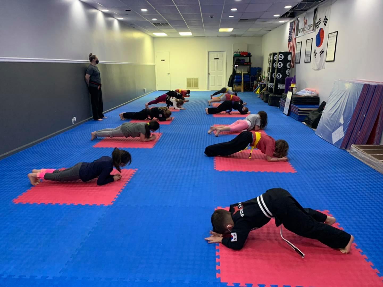 kids doing a plank on a karate mat
