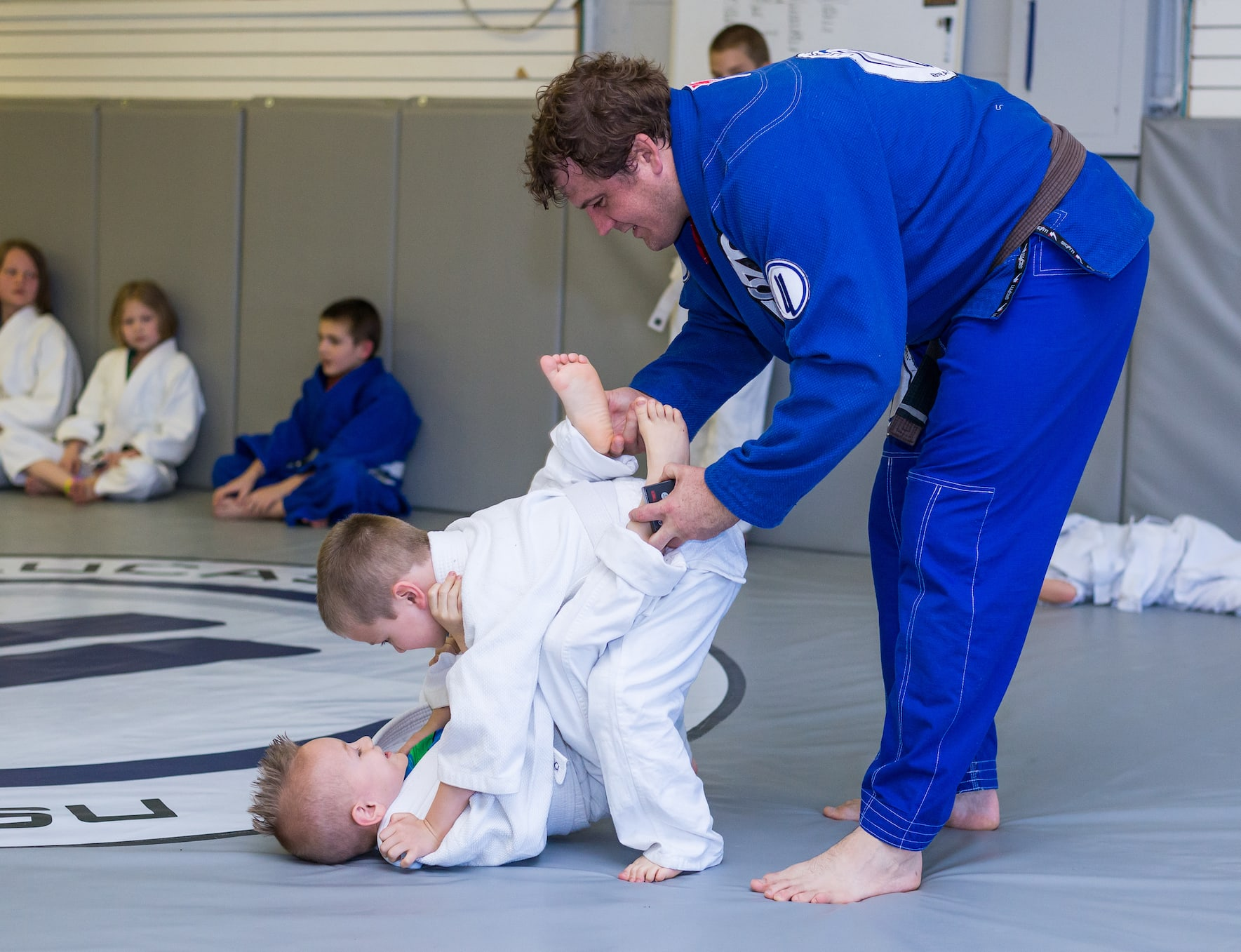 <style> h1 {   text-shadow: 2px 2px 8px #1e2a55; } </style>Helping Knoxville Master The Skills of Ground Grappling