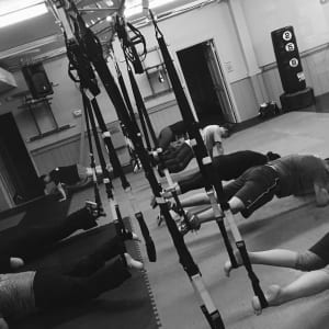 students in trx suspension training  in Chicago - Ultimate Martial Arts - Chicago