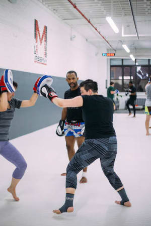 students in muay thai kickboxing in 	 Chicago - Mission MMA And Fitness
