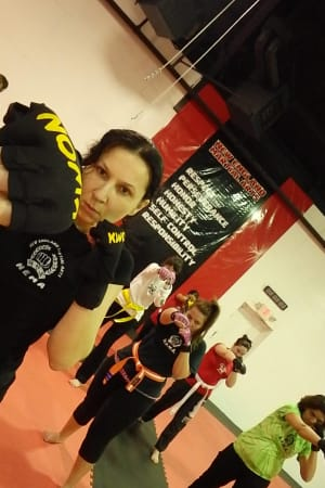 students in fitness kickboxing  in Marlborough - New England Martial Arts Athletic Center