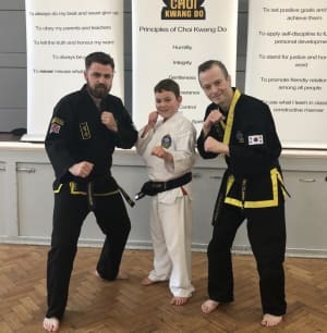 Teddington Choi Kwang Do First Black Belt in 7-12 years Junior Class!