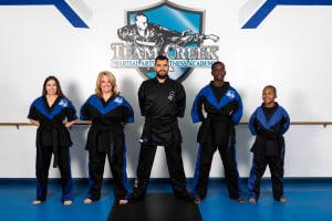 4 new Black Belt Graduates and 1 2nd degree Black Belt Graduate