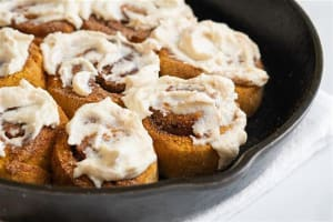 Pumpkin Spice Cinnamon Rolls with Maple Ricotta Frosting
