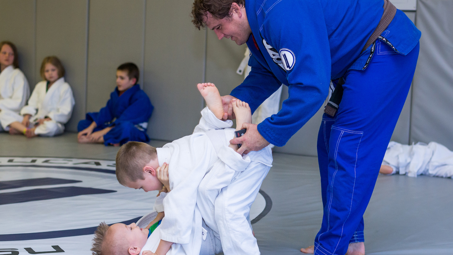 "<style> v {   text-shadow: 2px 2px 8px #1e2a55; } </style><v style=""color:white""><strong>Kids Martial Arts 