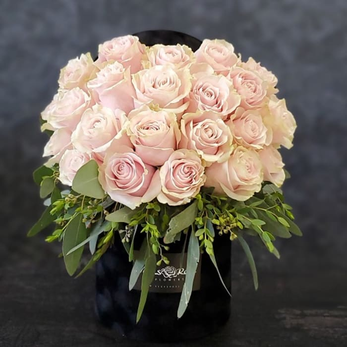 LIGHT PINK ROSES IN ANY BLACK BOX