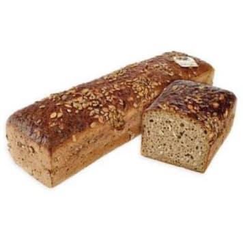 Chleb Magnat połówka - Putka doprawiony jest nasionami słonecznika i pestkami z dyni.