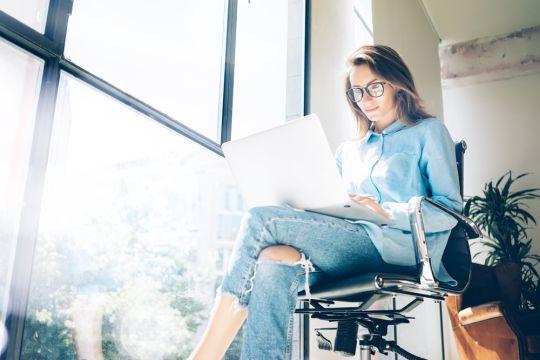 hipster-woman-working-laptop-loft